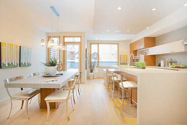 modern open concept kitchen and dining room modern metal dining chairs and bar stools light toned interior light wood trims for windows and door