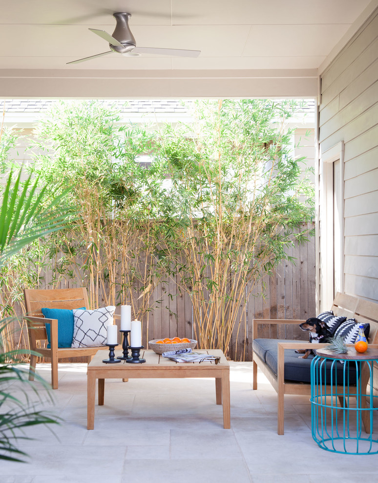 patio living room with greenery and wood furniture set