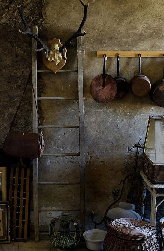 rustic kitchen idea copper panel for cookingware wood ladder concrete walls