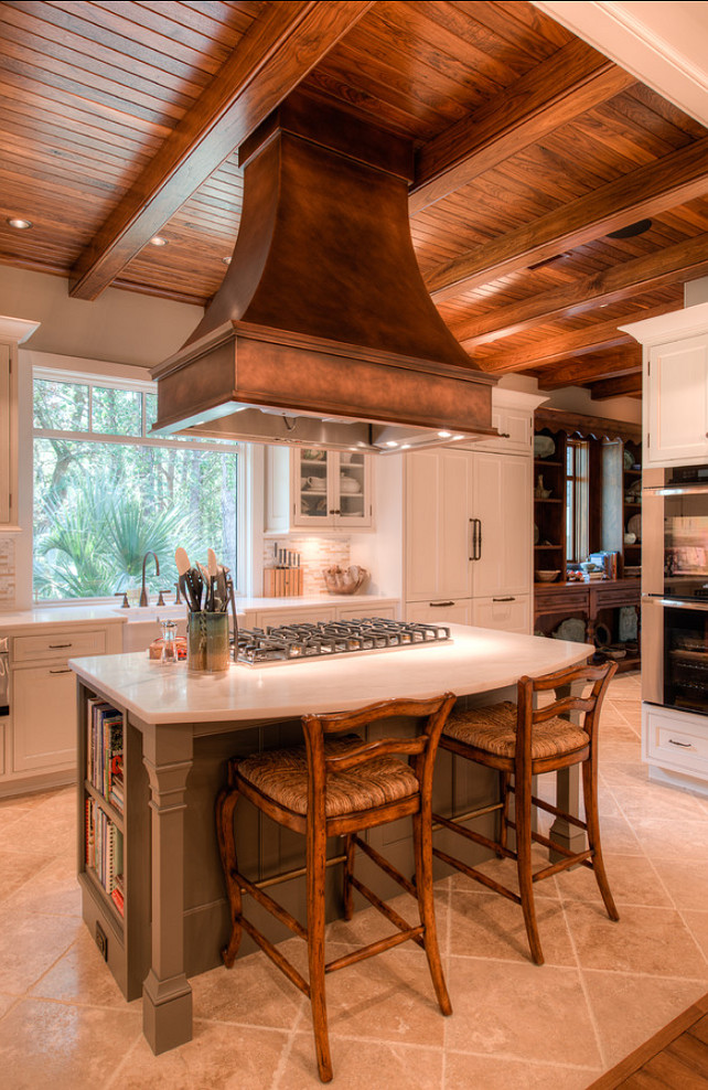 semi rustic kitchen idea traditional kitchen island with white top wood stools white kitchen cabinets ceramic tiled floors wood ceilings