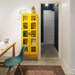 Simple Home Office Yellow Storage With Glass Door Wood Computer Desk Mid Century Modern Chair In Blue Ethnic Carpet Concrete Floors