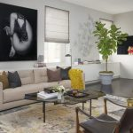 Spring Concept Living Room Light Beige Sofa Neutral Throw Pillows Yellow Wool Blanket Glass Top Coffee Table Textile Rug Dark Chairs