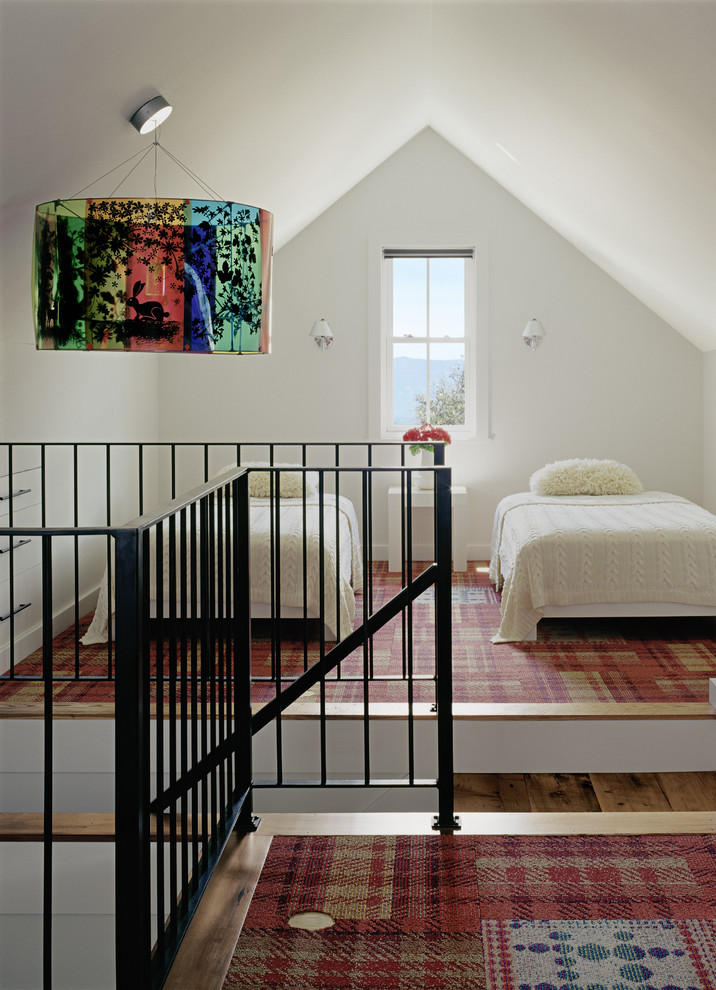 transitional kids bedroom custom carpet in red color black wrought iron railings attic roof in white twin bed frame centered window