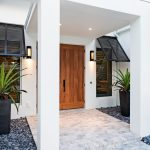 Tropical Entryway Idea Hardwood Front Door Front Windows With Black Finish Trims And Shutter White Ceramic Tiled Floors Natural Stone Landscape