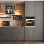 Ultra Modern Kitchen Trend Concrete Sprayed Cabinets Metal Framed Oven Heavy Metal Racks Low Lighted Lamps