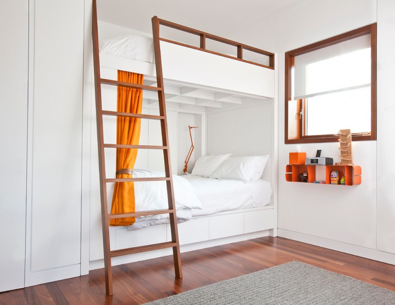 clean look kids' room in white and wood finishing dark toned wood floors white bunk bed with wood ladder and railings