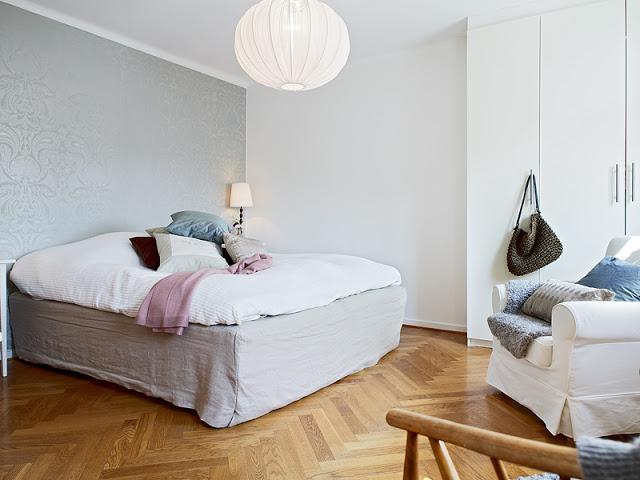 comfy bedroom with light color shade interior wood flooring idea light gray wallpaper huge lantern like pendant in white