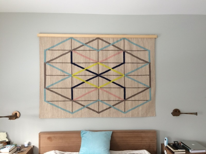 creative IKEA rug wall decor in neutral color
