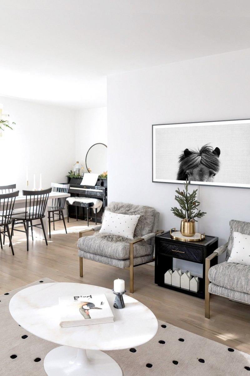 gray chairs with brass constructions polka dots throw pillows black side table light wood floors polka dots area rug white circular shaped coffee table in white