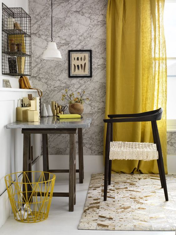 linen curtain in yellow dark wood furnishings marble like wallpaper