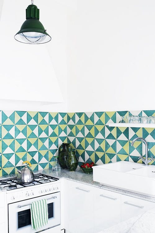 modern kitchen idea corner white kitchen counter white sink green white yellow tiled backsplash pendant with green lampshade