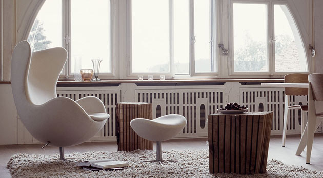 modern white open space modern white lounge chair and table woolly white area rug vertical wood planks center tables