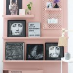 Movable Art Display Wall Idea In Dusty Rose Striped Black White Area Rug Some Mini Houseplant