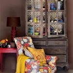 Muddy Toned Display Rack Pop Of Colored Armchair With Mustard Blanket & Throw Pillow