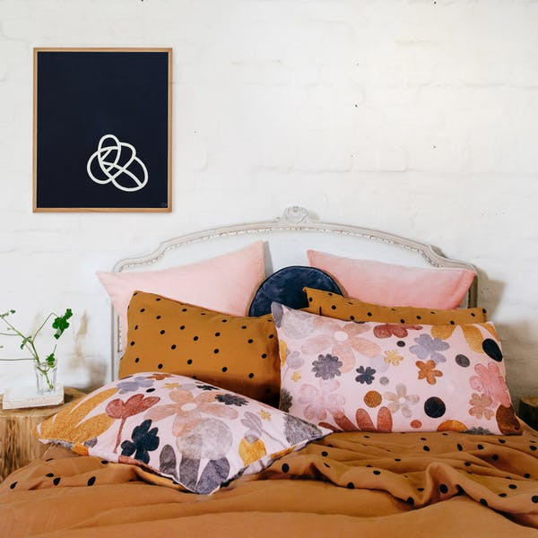 multicolored bedroom idea bed frame with white headboard dark brown comforter & pillows with black polka dots floral patterned pillows