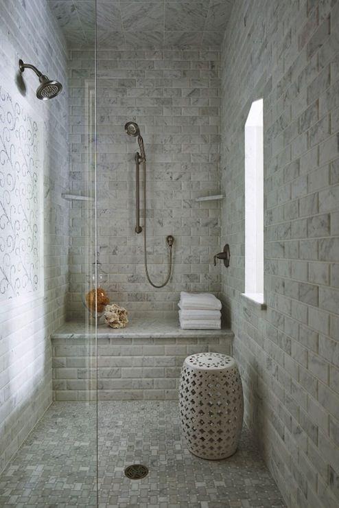 pale toned bathroom idea whitewashed subway tile walls whitewashed mosaic tile floors white painted garden stool white shower bench