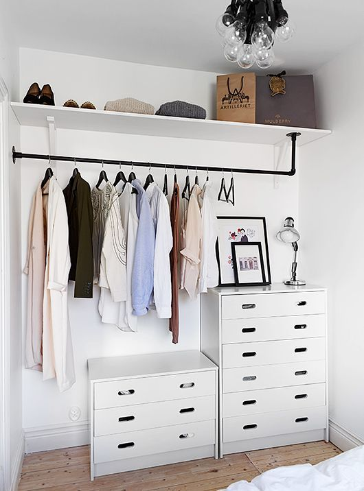 practical open walk in closet with additional drawer systems in white