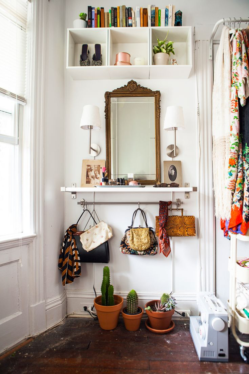 small entryway idea classic wood framed mirror a pair wall lamps sucullents on clay burnt pots white bookshelves