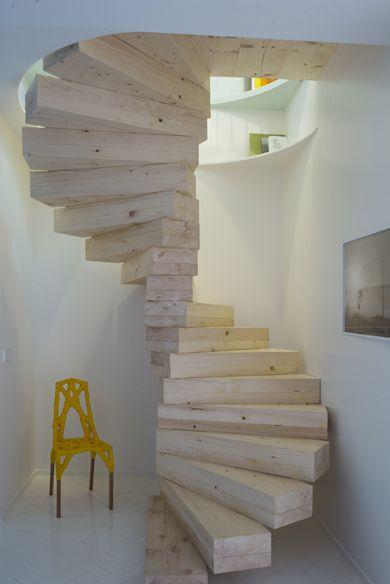 spiral light wood stairs idea mustard chair