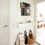 White Small Entryway Design Handy Storage Solution Consisting Of Wall Mounted Hooks And Shelf