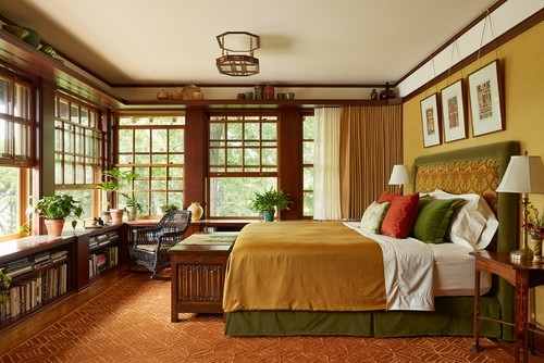 Mission Style bedroom design wood furniture mustard yellow comforter green bed frame burnt orange area rug