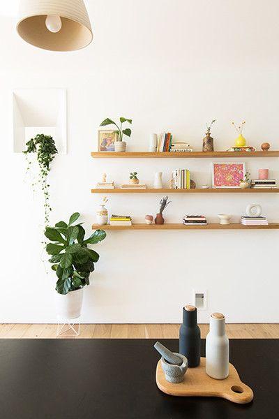 Scandinavian style bookshelves little greenery