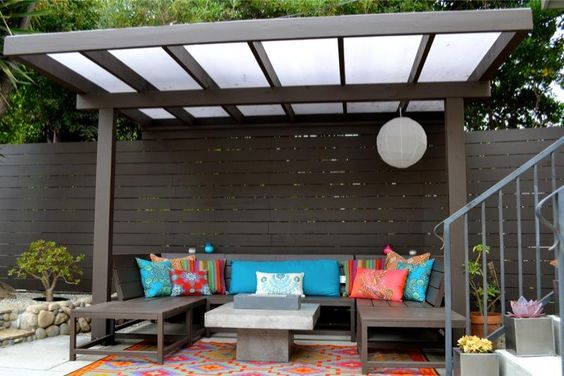 asian themed pergola with vinyl roof addition wood furniture colorful throw pillows colorful area rug