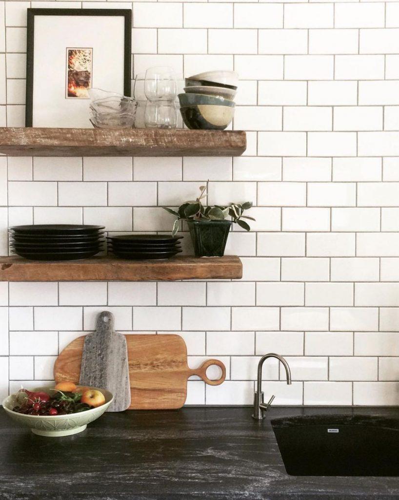 black granite kitchen countertop idea white subway tiles backsplash wooden open shelves