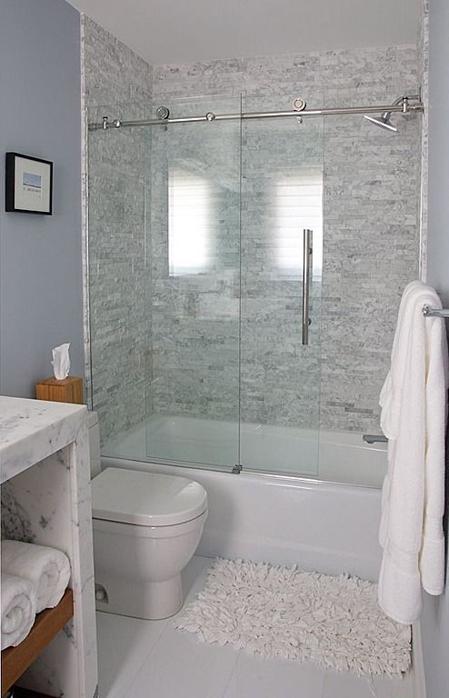 bright small bathroom design idea white toilet marble bathroom vanity counter white bathtub with clear glass door wooly white bathroom mat