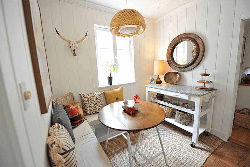 corner breakfast nook idea round wood table with tiny legs L shaped bench in white multicolored bench seat knitted wool carpet movable hall console table in white decorative round wall mirror