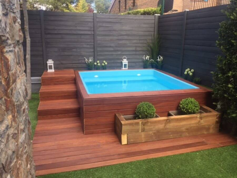 full privacy in ground hot tub idea dark finishing pallet walls hard textured wall wood decking floors and stairs