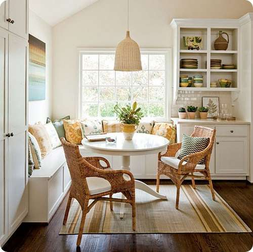 homey breakfast nook earthy brow area rug woven furniture built in bench seat white corner cabinet with display section minimalist pendant with woven lampshade