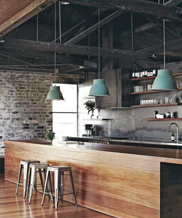 industrial kitchen idea brick walls concrete walls dark ceilings exposed metals hardwood kitchen island
