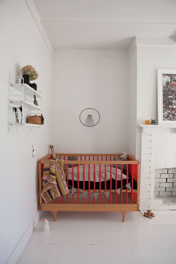 light rustic nursery room white interior wooden baby crib with red accent wall mounted rack in white