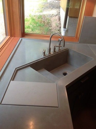 modern corner sink with sliding cutting board in doff dark finishing