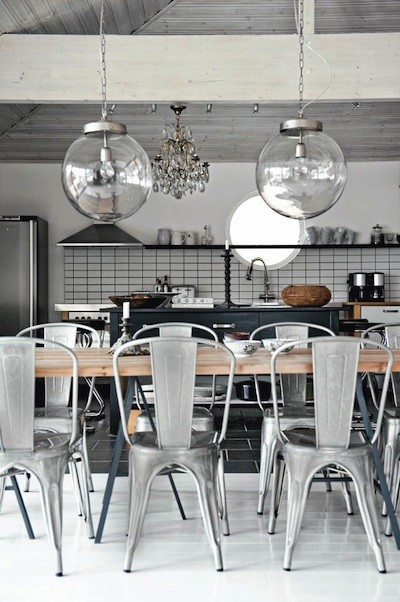 modern eat in kitchen idea metal vintage dining chairs block butcher dining table with black wrought iron legs large glass orbs as pendants