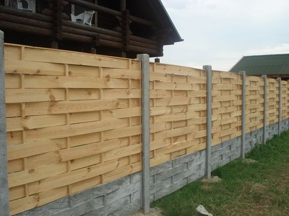 modern wood fences idea with concrete base and post support