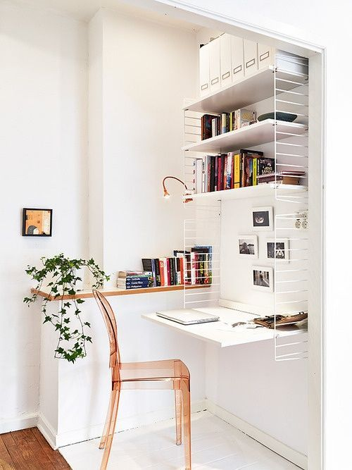 open shelves supported by wire panelings simple white wall mounted desk acrylic chair