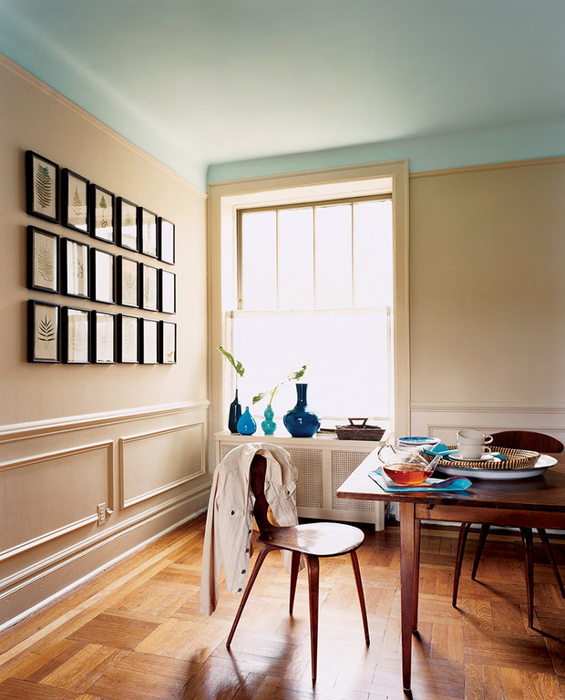 pale & creamy wall paint color idea dark wood dining furnishings dreamy blue ceilings