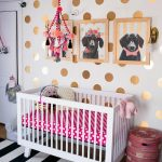 Polka Dots Themed Nursery Room White Baby Crib With Polka Dots Bed Linen White Black Striped Area Rug Gold Polka Dots Wallpaper