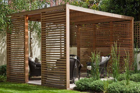 rustic pergola design with privacy screen dark wicker furniture