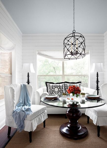 traditional breakfast nook idea white chair slipcovers round glass dining table traditional pendant with black wrought iron net shade