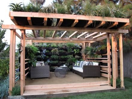 traditional wooden pergola with living roof and vibrant side black finish wicker furniture set