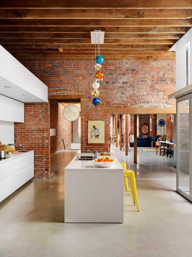 ultra modern industrial kitchen design white clean line furnishings pop of yellow stools unique & colorful pendant red brick walls