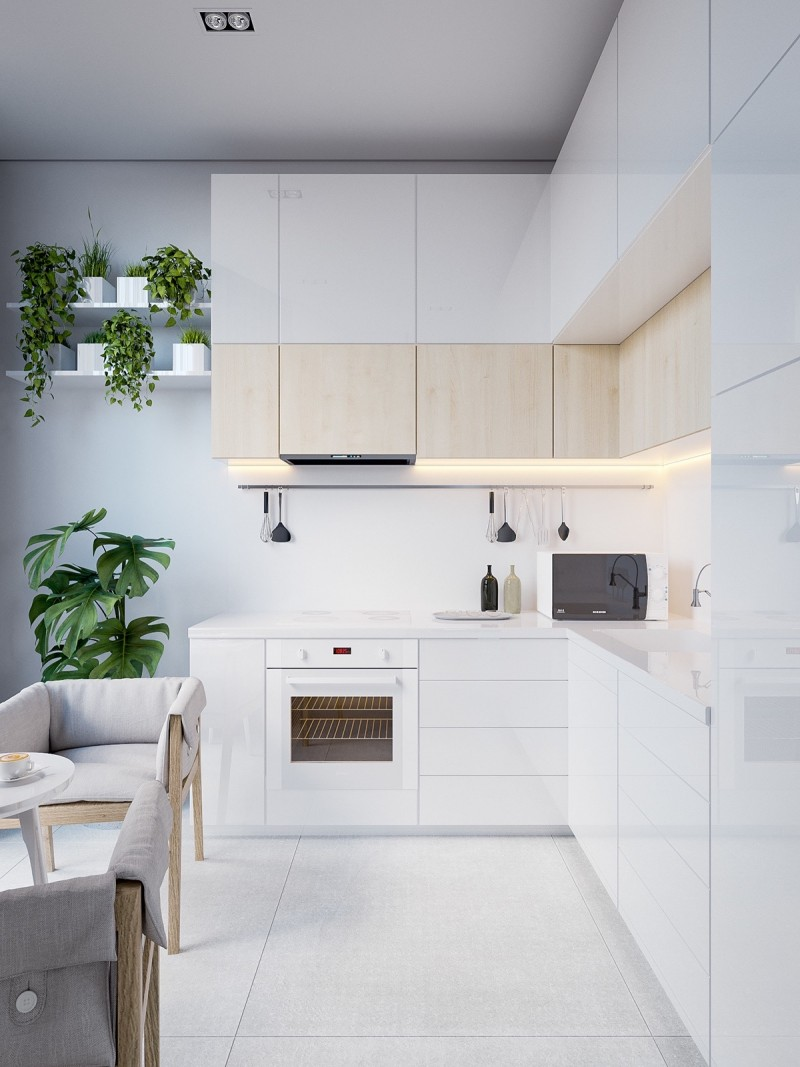 Scandinavian kitchen with minimal look flat paneled white & lighter wood cabinets potted plants white floors