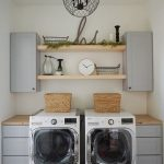 Clean And Modern Laundry Room Light Gray Floating Cabinets Light Wood Open Shelves Washing Machine Drying Machine Monochrome Rug In Modern Style