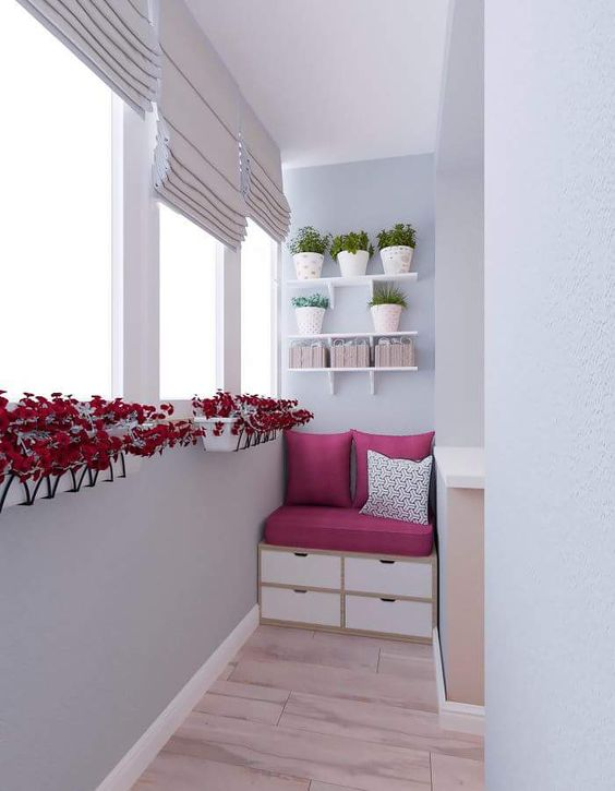 clean & sleek screened balcony girly pink seat with under storage units floating white pots with red flowers modern white screen windows