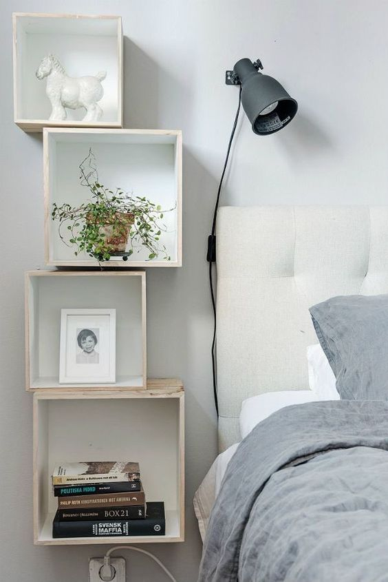 creative DIY nightstand consisting of piled shelves