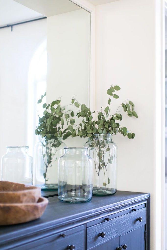 deep blue buffet clear glass jars wood serving bowls