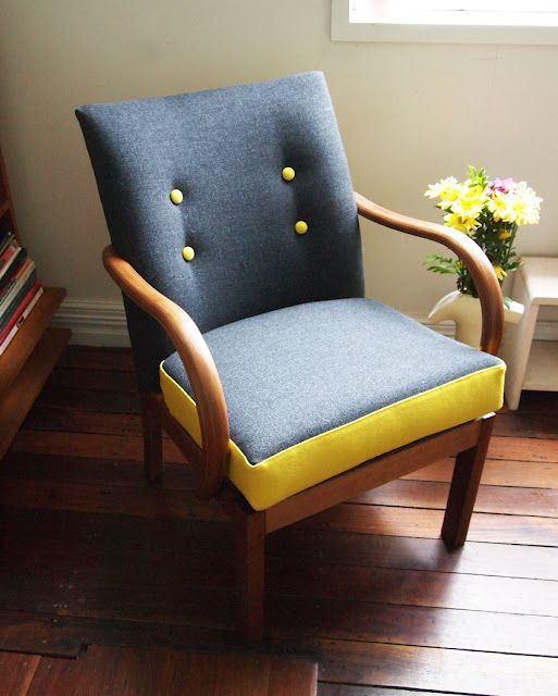 gray upholstered mid century modern chair with yellow highlight